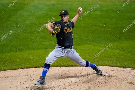 Pittsburgh Pirates starting pitcher Derek Holland throws during the third inning of a baseball game against the Milwaukee Brewers, in Milwaukee