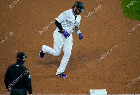 Colorado Rockies' Matt Kemp, top, circles the bases after hitting a three-run home run off San Diego Padres starting pitcher Zach Davies in the first inning of a baseball game, in Denver
