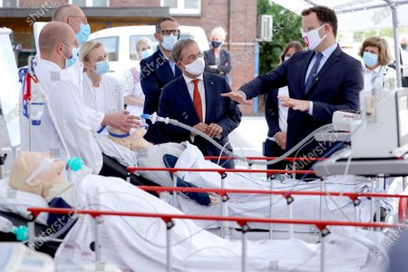 Head physician pneumology Thomas Voshaar and Senior physician internal medicine Daniela Kuehle run a demonstration for North Rhine-Westphalia Governor Armin Laschet and German Health Minister Jens Spahn during a visit in a tent used for coronavirus testing at the Bethanien hospital. Germany is wrestling with a sharp upswing in coronavirus infection rates that authorities attribute to vacationers returning from trips abroad.