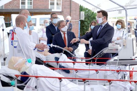 Stock Picture of Head physician pneumology Thomas Voshaar and Senior physician internal medicine Daniela Kuehle run a demonstration for North Rhine-Westphalia Governor Armin Laschet and German Health Minister Jens Spahn during a visit in a tent used for coronavirus testing at the Bethanien hospital. Germany is wrestling with a sharp upswing in coronavirus infection rates that authorities attribute to vacationers returning from trips abroad.
