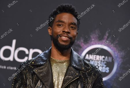 Chadwick Boseman poses in the press room at the American Music Awards at the Microsoft Theater in Los Angeles. Actor Chadwick Boseman, who played Black icons Jackie Robinson and James Brown before finding fame as the regal Black Panther in the Marvel cinematic universe, has died of cancer. His representative says Boseman died Friday, Aug. 28, 2020 in Los Angeles after a four-year battle with colon cancer. He was 43