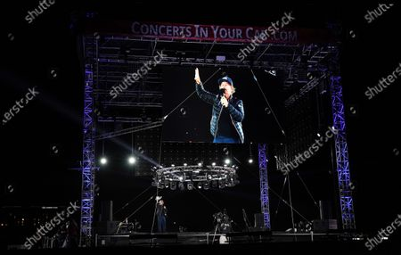 """Comedian David Spade is seen on a stage monitor as he performs at """"Comedy In Your Car"""" at the Ventura County Fairgrounds, Friday, Aug. 28. 2020, in Ventura, Calif"""