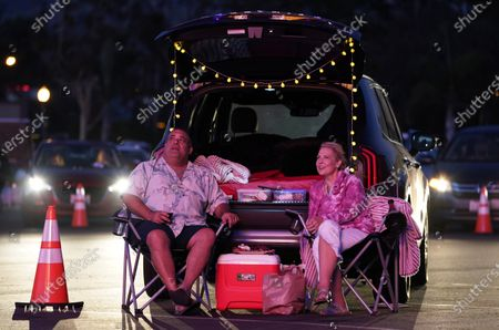 """Tige Licato, left, and his wife Christy watch """"Comedy In Your Car"""" at the Ventura County Fairgrounds, Friday, Aug. 28. 2020, in Ventura, Calif"""
