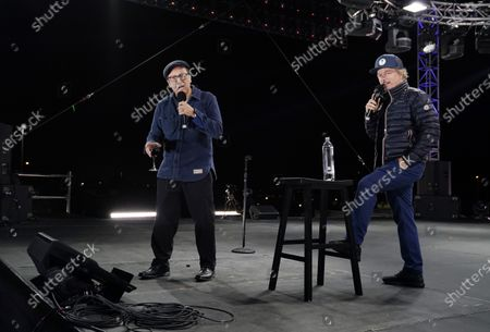 """Comedians Rob Schneider, left, and David Spade perform onstage at """"Comedy In Your Car"""" at the Ventura County Fairgrounds, Friday, Aug. 28. 2020, in Ventura, Calif"""