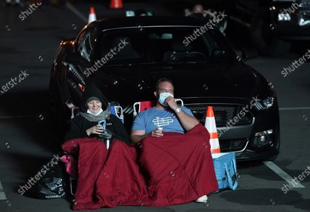 """Crowd members laugh during comedian David Spade's performance at """"Comedy In Your Car"""" at the Ventura County Fairgrounds, Friday, Aug. 28. 2020, in Ventura, Calif"""