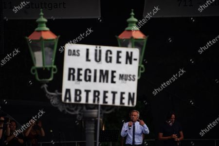 US lawyer and environmental activist Robert Francis Kennedy Jr. (2-R) speaks, as a placard reads 'The lying regime must cede', during a protest against coronavirus pandemic regulations in Berlin, Germany, 29 August 2020. The initiative 'Querdenken 711' and an alliance of right wing groups have called to demonstrate against coronavirus regulations like face mask wearing, in Berlin. Meanwhile forbidden, Berlin administrative court and higher administrative court allowed the demonstration to take place under certain requirements. Police announced to stop the demonstration when conditions were not met.