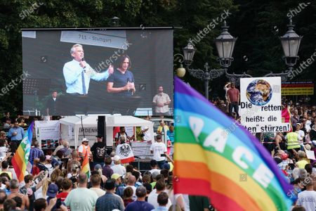 US lawyer and environmental activist Robert Francis Kennedy Jr. is seen on a screen during a protest against coronavirus pandemic regulations in Berlin, Germany, 29 August 2020. The initiative 'Querdenken 711' and an alliance of right wing groups have called to demonstrate against coronavirus regulations like face mask wearing, in Berlin. Meanwhile forbidden, Berlin administrative court and higher administrative court allowed the demonstration to take place under certain requirements. Police announced to stop the demonstration when conditions were not met.