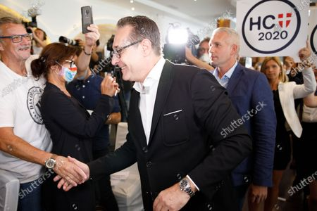 Heinz-Christian Strache (C), former Austrian vice chancellor and head of 'Team HC Strache' party, shakes hands as he arrives to attend the party's election campaign kick-off event in Vienna, Austria, 29 August 2020. The right-wing populist party launched the campaign for Strache's candidacy to the 2020 Vienna City Council and District Councils elections that are scheduled to be held in October 2020.