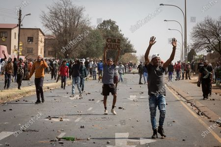 People march on a road during a protest over the death of a teenager in Eldorado Park, Johannesburg, South Africa, Aug. 27, 2020. South African President Cyril Ramaphosa on Friday sent condolences to the family of Nathaniel Julius, a 16 year-old boy allegedly killed by the police this week. It is alleged that Nathaniel Julius left home searching for food early this week and was shot dead by the police.