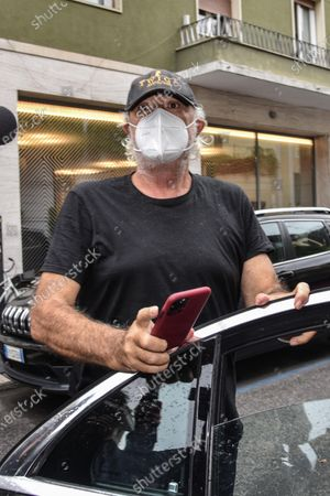 Italian businessman Flavio Briatore arrives at the home of his friend and senator Daniela Santanche, where he will spend domestic isolation after being released from the San Raffaele hospital and the confirmation of his positivity to the coronavirus, in Milan, Italy, 29 August 2020. Briatore was hospitalised on 25 August at Milan's San Raffaele Hospital after contracting the coronavirus at his Sardinian nightclub.
