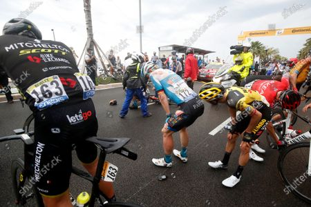 German rider Andre Greipel (C) of the Israel Start-Up Nation team reacts after crashing during the 1st stage of the 107th edition of the Tour de France cycling race over 156km around Nice, France, 29 August 2020.