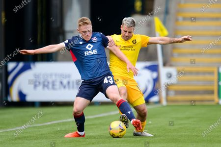 Josh Reid (#43) of Ross County FC and Scott Robinson (#17) of Livingston FC tussle for the ball during the Scottish Premiership match between Livingston and Ross County at Tony Macaroni Arena, Livingston