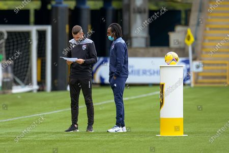 Stuart Kettlewell, manager of Ross County FC (left) and Regan Charles-Cook (#17) of Ross County FC check the team lines before the Scottish Premiership match between Livingston and Ross County at Tony Macaroni Arena, Livingston