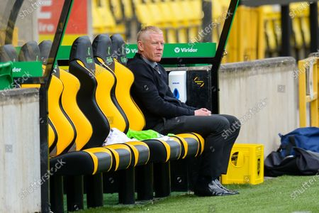 Livingston manager Gary Holt watches his players warm up from the bench before the Scottish Premiership match between Livingston and Ross County at Tony Macaroni Arena, Livingston