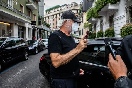 Stock Picture of The business owner Flavio Briatore, discharged from the hospital after having tested positive for Covid-19, arrives at the home of Daniela Santanche, where he will pass the quarantine. There are 58 positive cases of Covid-19 among the employees of the Billionaire, the well-known venue in Porto Cervo owned by Briatore, closed after the controversy over the crowded nightclubs in August. Milan, Italy 29-08-2020