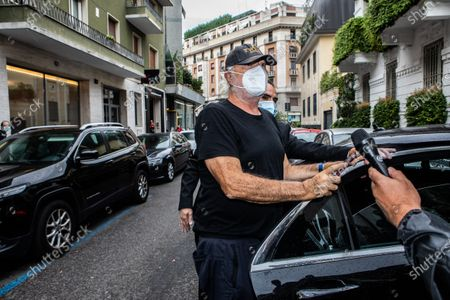 Stock Photo of The business owner Flavio Briatore, discharged from the hospital after having tested positive for Covid-19, arrives at the home of Daniela Santanche, where he will pass the quarantine. There are 58 positive cases of Covid-19 among the employees of the Billionaire, the well-known venue in Porto Cervo owned by Briatore, closed after the controversy over the crowded nightclubs in August. Milan, Italy 29-08-2020