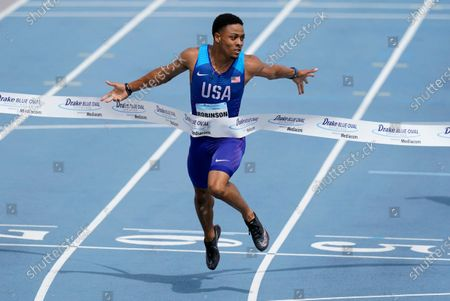 Justin Robinson crosses the finish line during the Blue Oval Showcase men's 200-meter dash, at Drake Stadium in Des Moines, Iowa