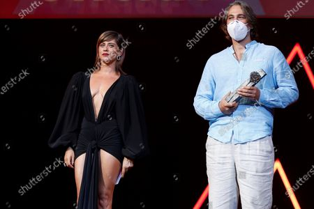 Argentinian actor Alberto Ammann (R), next to Spanish actress Maria Leon, receives the best actor prize 'Biznaga de Plata' for his film 'El silencio del Cazador' during the closing ceremony of the 23rd edition of Malaga Film Festival in Malaga, Spain, 29 August 2020.