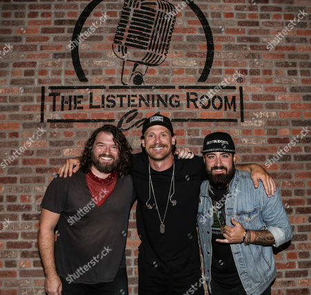 Stock Photo of Singer & songwriter (L-R) MIchael Whitworth, Chase Rice and Eric Van Houten pose for a photo at The Listening Room Cafe on August 28, 2020 in Nashville, Tennessee.