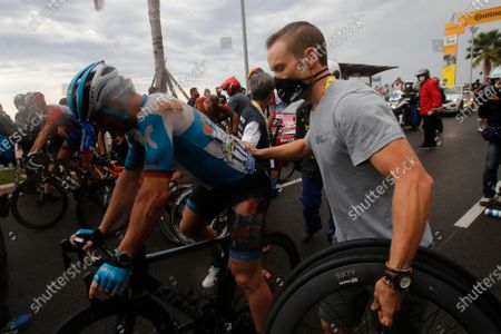 German Andre Greipel is pushed by a mechanic after he crashed during the first stage of the Tour de France cycling race over 156 kilometers (97 miles) with start and finish in Nice, southern France