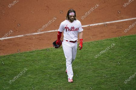 Stock Photo of Philadelphia Phillies' Bryce Harper walks off the feld after flying out against Atlanta Braves pitcher Josh Tomlin during the third inning of a baseball game, in Philadelphia