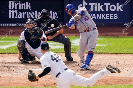 New York Mets' Wilson Ramos hits a solo home run off New York Yankees relief pitcher Adam Ottavino during the eighth inning of a baseball game, in New York