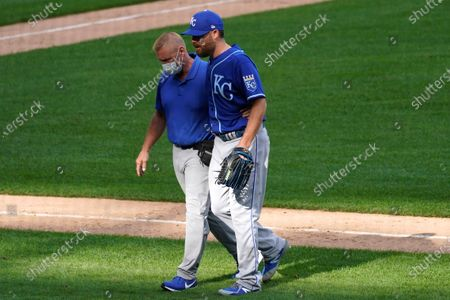 Stock Image of Kansas City Royals relief pitcher Ian Kennedy, right, leaves with a team trainer after an injury during the ninth inning of a baseball game against the Chicago White Sox in Chicago, . The Royals won 9-6