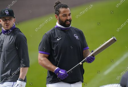Colorado Rockies left fielder Matt Kemp, right, talks with shortstop Trevor Story as they warm up before a baseball game against the San Diego Padres, in Denver