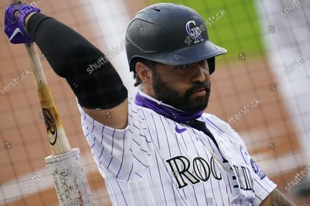 Colorado Rockies' Matt Kemp waits in the on-deck circle to face San Diego Padres starting pitcher Michel Baez in the first inning of a baseball game, in Denver