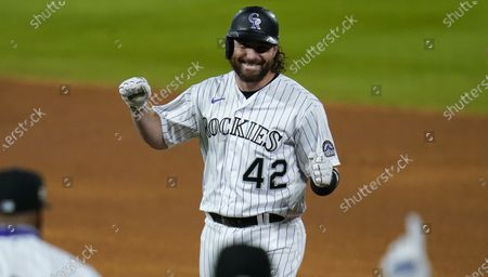 Colorado Rockies pinch-hitter Daniel Murphy celebrates after his walkoff RBI-single off San Diego Padres relief pitcher Craig Stammen in the ninth inning of a baseball game, in Denver
