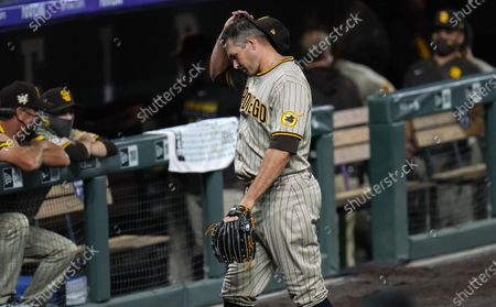Stock Image of San Diego Padres relief pitcher Craig Stammen heads to the dugout after giving up a walkoff RBI-single to Colorado Rockies pinch-hitter Daniel Murphy in the ninth inning of a baseball game, in Denver