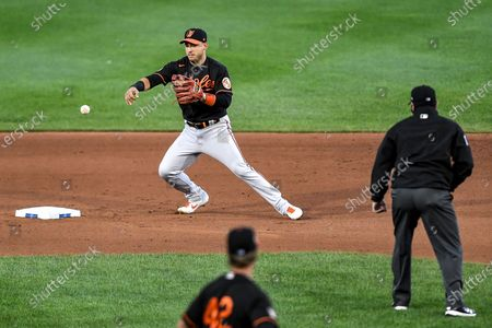 Baltimore Orioles shortstop José Iglesias bobbles the ball but Toronto Blue Jays' Travis Shaw was called out at second base on a ball hit by Derek Fisher during the fourth inning of a baseball game in Buffalo, N.Y., . The Blue Jays won 5-0