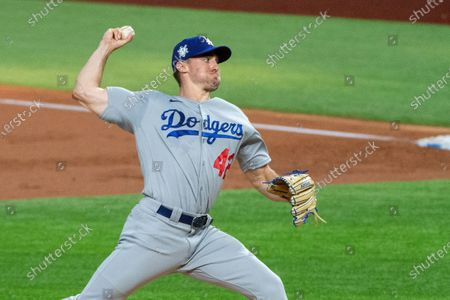 Los Angeles Dodgers starting pitcher Ross Stripling works against the Texas Rangers during the first inning of a baseball game, in Arlington, Texas