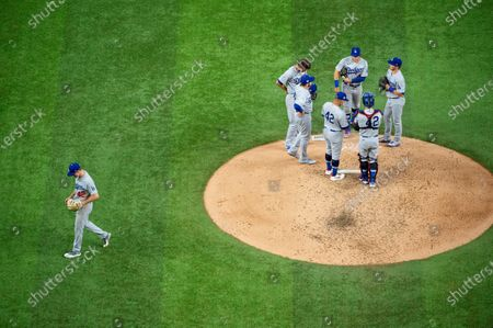 Los Angeles Dodgers starting pitcher Ross Stripling, left, leaves a baseball game after being pulled by manager Dave Roberts during the fifth inning against the Texas Rangers, in Arlington, Texas