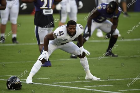 Baltimore Ravens Anthony Levine Sr. warms up during an NFL football training camp practice, in Baltimore, Md