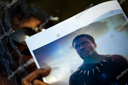 A woman holds a picture of late US actor Chadwick Boseman during a vigil to honor his memory in Leimert Park, Los Angeles, California, USA, 29 August 2020. Chadwick Boseman passed away, age 43, after a four year battle with colon cancer.