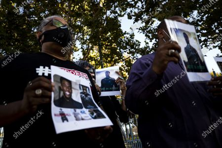 People hold pictures of late US actor Chadwick Boseman during a vigil to honor his memory in Leimert Park, Los Angeles, California, USA, 29 August 2020. Chadwick Boseman passed away, age 43, after a four year battle with colon cancer.