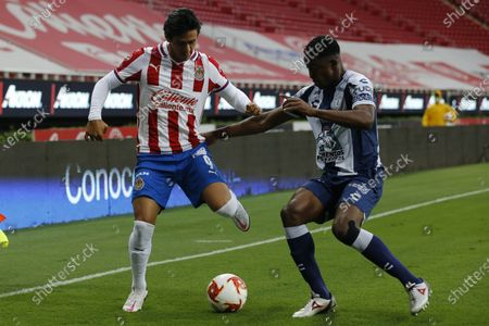The player Jose Juan Macias (L) of Chivas in action against Pachuca's Oscar Murillo (R) during the match between Chivas de Guadalajara and Pachuca in the Guardians 2020 tournament at the Akron Stadium in Guadalajara, Jalisco, Mexico, 29 August 2020.