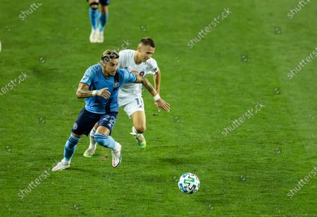 Ronald Matarrita (22) of NYCFC controls ball during MLS regular season game against Chicago Fire FC at Red Bull Arena. Game was played without fans because of COVID-19 pandemic precaution. NYCFC won 3 - 1. All supporting staff and players on the bench were wearing facial masks and kept social distances.