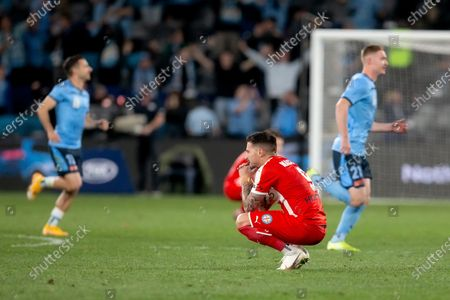 Melbourne City forward Jamie Maclaren (9) at full time as Sydney FC players celebrate