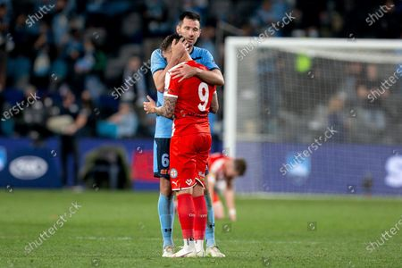 Stock Picture of Sydney FC defender Ryan McGowan (6) hugs Melbourne City forward Jamie Maclaren (9) at full time