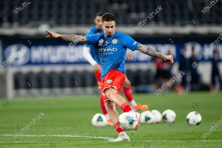 Stock Photo of Melbourne City forward Jamie Maclaren (9) shoots during warm up