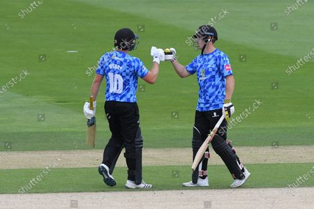 Luke Wright of Sussex and Phil Salt of Sussex celebrate Wright's 50  during the Vitality T20 Blast South Group match between Sussex County Cricket Club and Hampshire County Cricket Club at the 1st Central County Ground, Hove