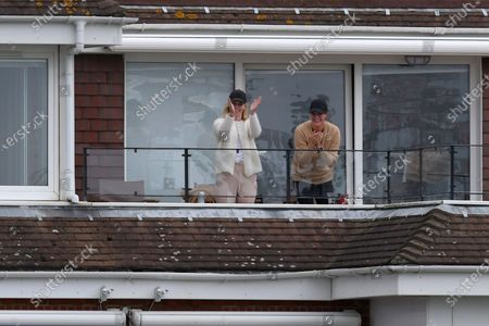 Supporters in the adjacent flats applaud Luke Wright of Sussex's 50 during the Vitality T20 Blast South Group match between Sussex County Cricket Club and Hampshire County Cricket Club at the 1st Central County Ground, Hove