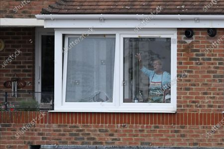 Broken window - The occupant of a flat overlooking the ground looks out after Luke Wright of Sussex broke her window during the Vitality T20 Blast South Group match between Sussex County Cricket Club and Hampshire County Cricket Club at the 1st Central County Ground, Hove
