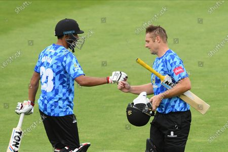 Ravi Bopara of Sussex fist pumps Luke Wright of Sussex after he had been dismissed for 82 during the Vitality T20 Blast South Group match between Sussex County Cricket Club and Hampshire County Cricket Club at the 1st Central County Ground, Hove
