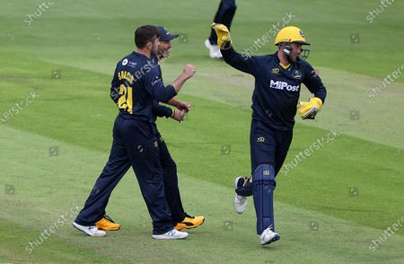 Andrew Salter and Chris Cooke celebrate after Ian Bell is caught by Billy Root