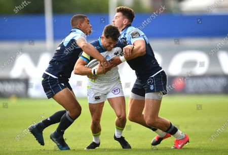 Luke Morgan of Ospreys is tackled by Ben Thomas and Jason Harries of Cardiff Blues.