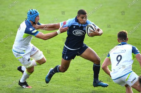 Stock Image of Ben Thomas of Cardiff Blues holds off Justin Tipuric of Ospreys.