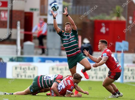 Ben Youngs of Leicester leaps to catch the loose ball